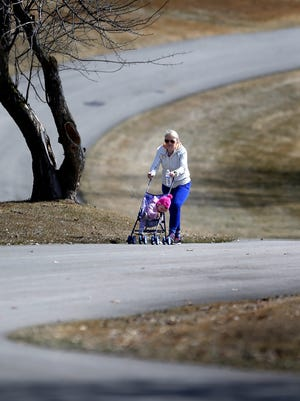 Chryl Moak takes a walk with her granddaughter, Kinley Jandron, on March 30 at Outagamie County's Plamann Park in Grand Chute.