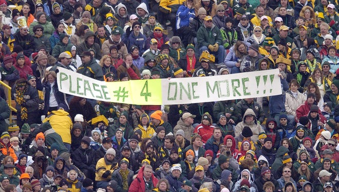 Green Bay Packer fans cheer quarterback Brett Favre during a game against the Seattle Seahawks at Lambeau Field on Sunday, Jan. 1, 2006. It was the last game of the 2005 season.