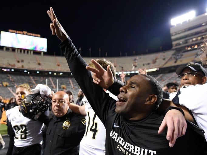 Vanderbilt Head Coach Derek Mason raises his hand towards