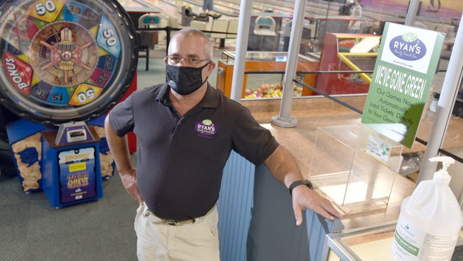 Peter Campbell stands in the arcade area at the Ryan's Family Amusements location in South Yarmouth, which remains closed under the state's COVID-19 guidelines. He said the company has spent more than $200,000 on air purifying systems, plexiglass shields, sanitizing equipment and other COVID-19 related equipment for its businesses in anticipation of an early July opening.