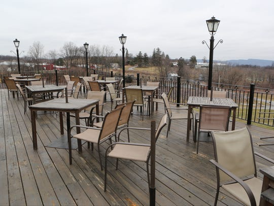 The outdoor dining area at Gunk Haus restaurant on South Street in Highland.