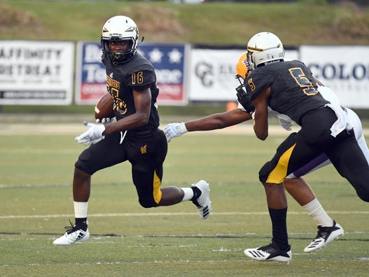 Oak Grove wide receiver Brandon Hayes takes the ball past the Purvis defensive during the first game of the season on Friday, August 17, 2018.