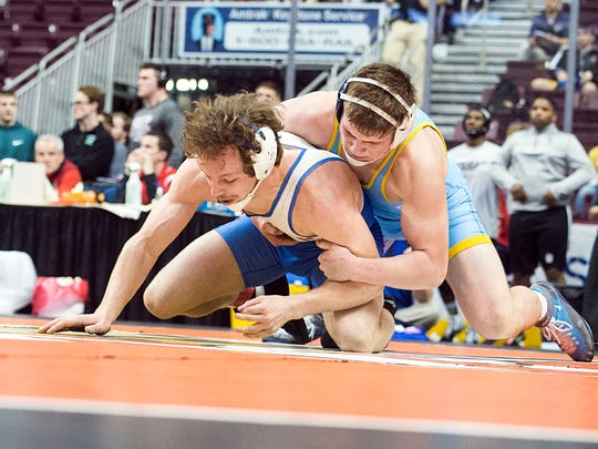 Cedar Cliff's Donovan Ball breaks down Spring Grove's Jared Barley, Thursday, February 23, 2017. The first day of the District 3 Championships started Thursday, and extends through Saturday.