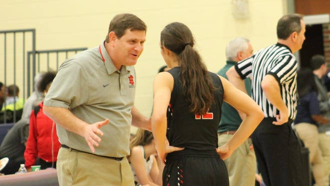 Indian Hill coach Chris Arington discusses the next play with senior Ellie Schaub.