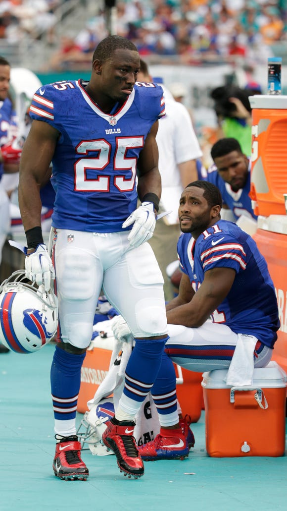 Buffalo Bills running back LeSean McCoy (25) walks the sidelines during the first half of the Bills' game against Miami.