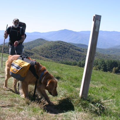Larry Kass of Raleigh, N.C. hikes with his dog on Max