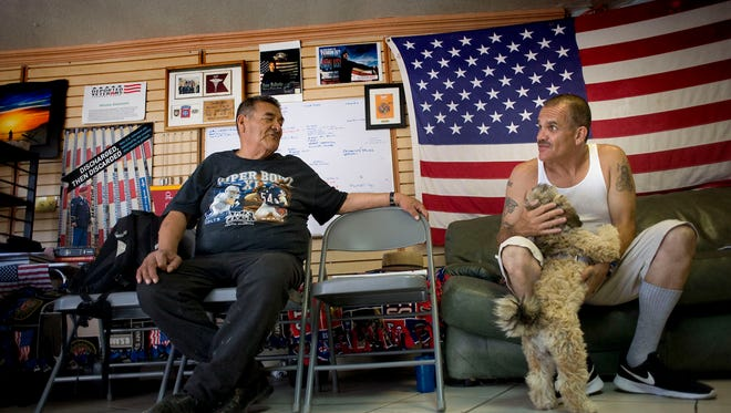 Deported U.S. military veterans, Andrew De Leon, left, and Alejandro Gomez Cortez, chat at the Deported Veterans Support House in Tijuana, Mexico, on June 19, 2017. The center, which is run by founder and director Hector Barajas, lobbies for deported veterans  to get their Veterans Affairs benefits and other services, as well as temporary shelter.