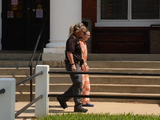 Diane Chapman exiting the Madison County courthouse.