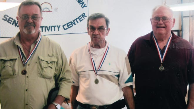 Three men from the Van Matre Senior Wellness & Activity Center 8-Ball Pool Tournament recently brought home medals from the Area Agency on Aging Senior Olympics of Northwest Arkansas Pool Tournament. Shown are, from left, Ed Miller, bronze medal; Paul Herrick, gold medal, and Roy Rush, silver medal.