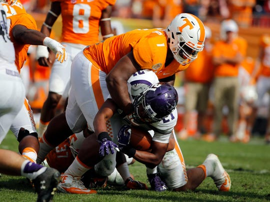 Tennessee defensive lineman Kahlil McKenzie (1) tackles