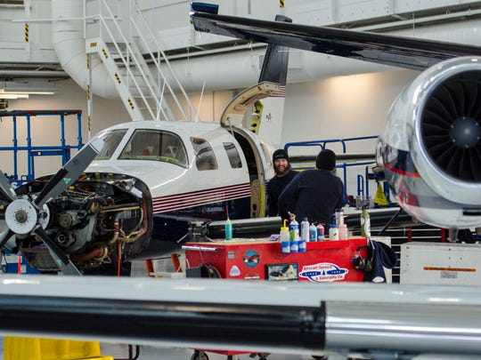 Aircraft mechanics work at Heritage Aviation at the Burlington International Airport in South Burlington on Wednesday, January 13, 2016.