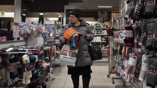 In this Jan. 7, 2019, photo a customer shops in a Sears store in the Brooklyn borough of New York. U.S. retail sales rose slightly in January after a sharp drop in December, reflecting caution taken by consumers amid a government shutdown and volatile stock market.