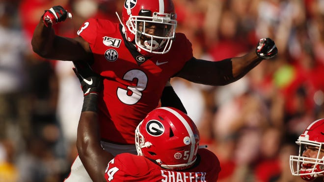 Georgia running back Zamir White (3) celebrates with Georgia offensive lineman Justin Shaffer (54) after scoring a touchdown in the first half of an NCAA football game between Georgia and in Athens, Ga., on Saturday, Sept. 7, 2019.