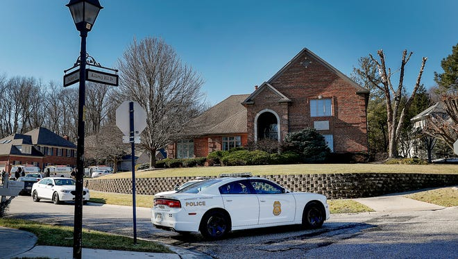 IMPD homicide detectives and forensics teams were on the scene of a body found in a home on the south side of Indianapolis Friday.