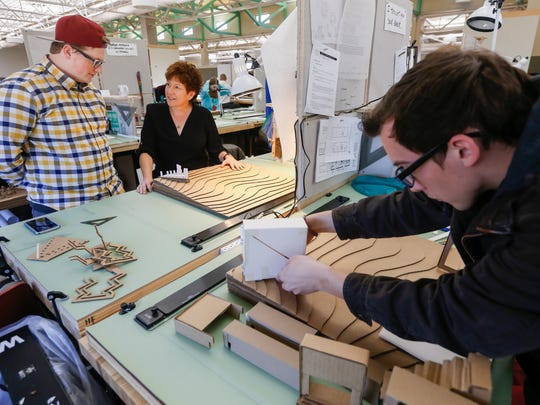 """Drury University has long offered """"real world"""" problem-solving as part of its coursework. In this architectural design class in February 2018, Traci Sooter talks with student Hunter Farrell. The class was designing and building a model for a threshold and contemplation space in a park."""