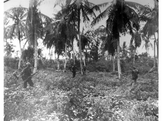 U.S. Marine infantry moving near old Marine barrack near Sumay, Orote Peninsula on July 28, 1944.