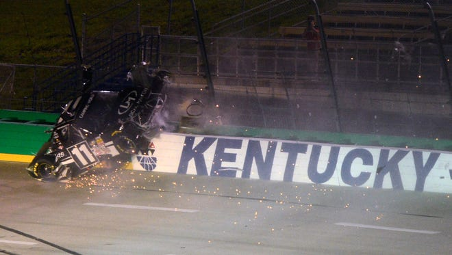 Ben Kennedy crashes into the fence and wall during the Camping World Truck Series race at Kentucky Speedway.