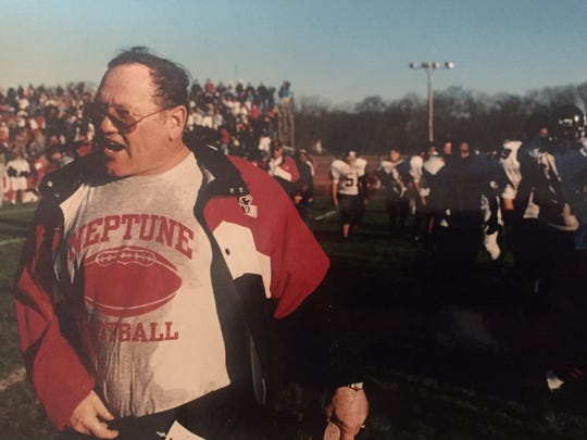 Neptune coach John Amabile guided the Scarlet Fliers to perfect seasons in 1995 and 1997.
