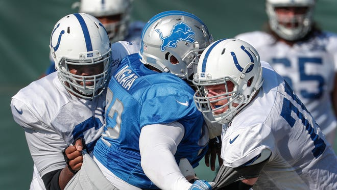 Indianapolis Colts offensive tackle Le'Raven Clark (62) and Jack Mewhort (75) battle Detroit Lions defensive tackle Haloti Ngata (92)  during their training camp practice at the Colts complex on West 56th Street Thursday morning August 10, 2017.