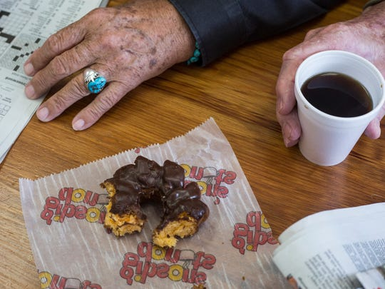 Regulars drink coffee, fill out crosswords, talk and