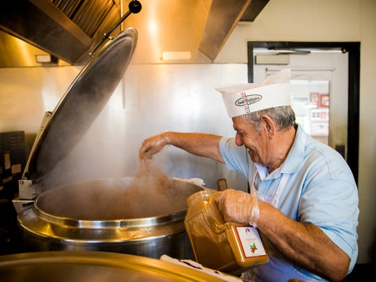 Angelo Soulas adds cinnamon to the meat sauce for the