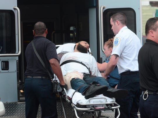 Ahmad Khan Rahimi is loaded into the ambulance on E. Elizabeth Ave on Sept. 19, 2016 in Linden.