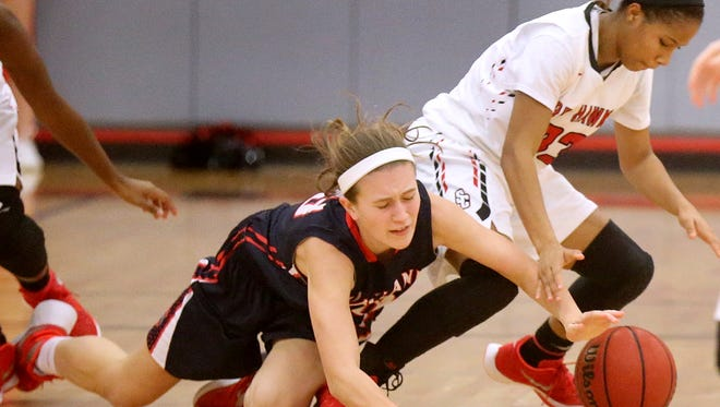 Oakland's Maggie Knowles (23) and Stewarts Creek's Brandi Ferby (33)  both fall to the floor while trying to gain control of a loose ball during the game on Friday, Feb. 5, 2016, at Stewarts Creek.