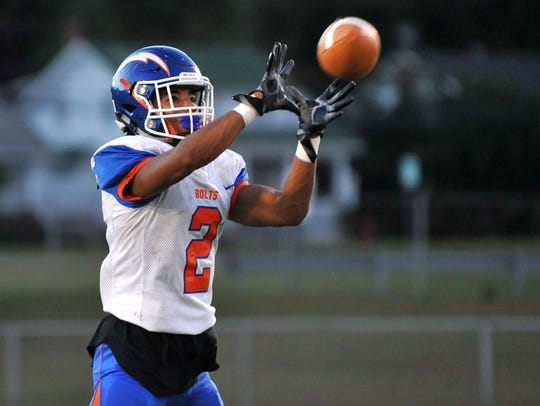 Millville's Marcial Ramos makes a catch while warming
