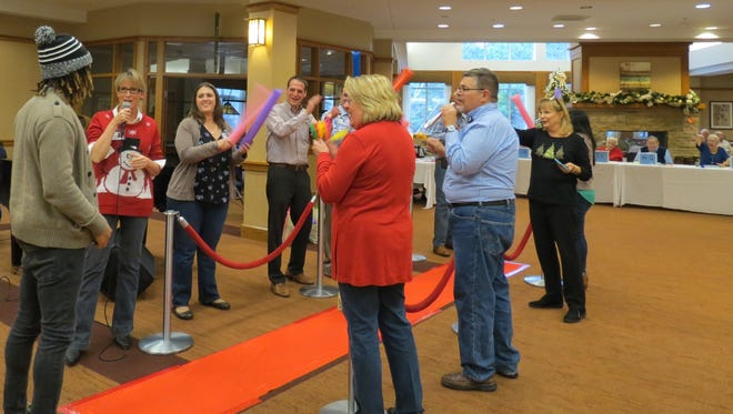 """Employees walk the """"red carpet"""" at Seabrook's Staff Appreciation Event."""