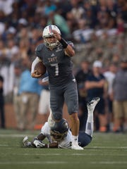 Troy quarterback Kaleb Barker has shown his running skills over the last two years.