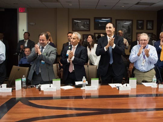 Members of the Lee Health Board of Directors and top leadership of Lee Health give a standing ovation to CEO/President Jim Nathan. Nathan is stepping down after more than three decades at the helm.
