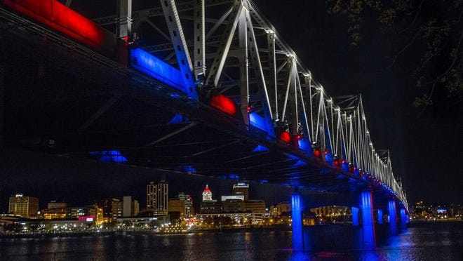 The newly lighted and newly rehabilitated Murray Baker Bridge shines after it was reopened. The Downtown Peoria skyline shines in the background.