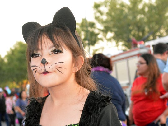 Nayla Rodriguez, 9, looks around at the displays and booths at inaugural HalloweenFest and Family Wellness Fair on Monday, Oct. 31, 2016, at the Doña Ana County Government Center parking lot.