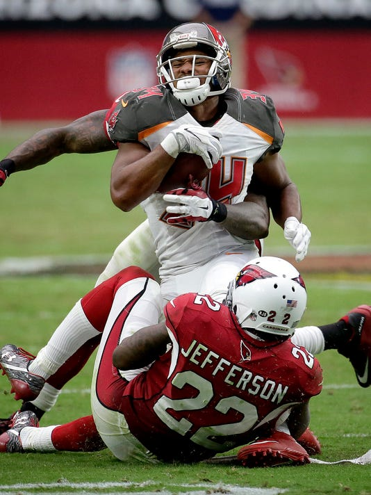 Tampa Bay Buccaneers cornerback Brent Grimes (24) is hit by Arizona Cardinals strong safety Tony Jefferson (22) during the second half of an NFL football game, Sunday, Sept. 18, 2016, in Glendale, Ariz. (AP Photo/Rick Scuteri)