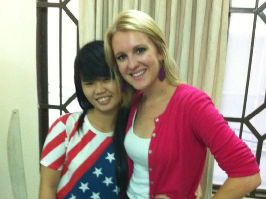 Pamela Kunkel with an English-language student that she is teaching in Vietnam.