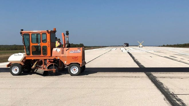 Contractors worked five days this month to repair 12 cracks in the Forney Airfield runway.