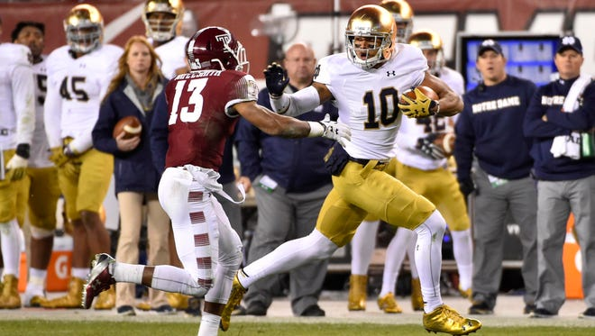 Alize Jones (10) runs the ball past Temple Owls defensive back Nate L. Smith (13) during the second half at Lincoln Financial Field. Notre Dame won 24-20.