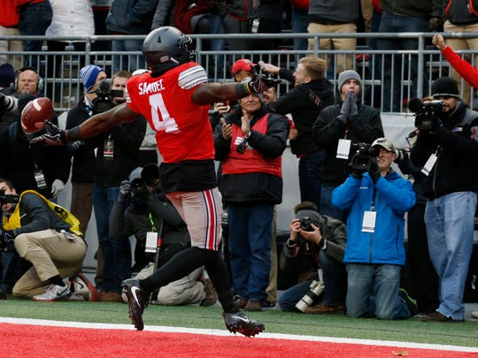 Ohio State running back Curtis Samuel celebrates his game-winning touchdown against Michigan during the second overtime of an NCAA college football game Saturday, Nov. 26, 2016, in Columbus, Ohio. Ohio State beat Michigan 30-27 in double overtime. (AP Photo/Jay LaPrete)