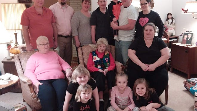 Family members gather around 99 year-old Marion Stein, of Penfield, during the holidays. She was born in 1915.