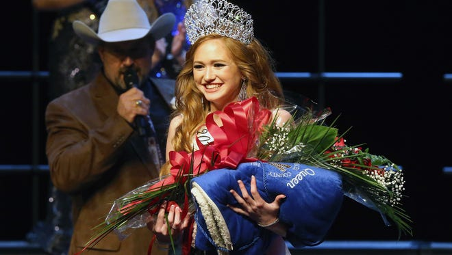 Reagan Hoelscher, from Run In JM 4-H Club, celebrates as she gets crowned 2017 Nueces County Junior Livestock Show Queen during the Sweethearts of the Livestock Show on Saturday, Jan. 14, 2017, at Tuloso-Midway High School in Corpus Christi.