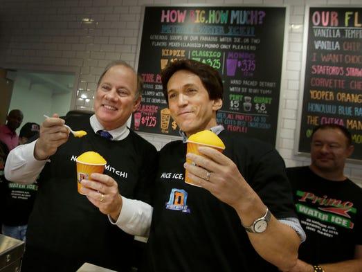 Detroit mayor Mike Duggan and Mitch Albom taste a Chika