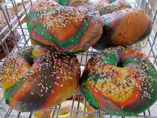 Specialty rainbow bagels are among the nearly 25 varieties