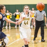 CMR's Cailey Froehle passes to a teammate while GFH's Molly Schmitz defends during the crosstown game in January.