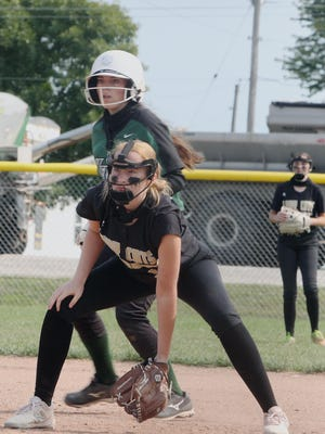 Cairo first baseman Morgan Taylor rests in a fielding position while Westran's Reanna Black shuffles off the bag on a pitch delivered in the second inning of Saturday's softball game at the Cairo Lady 'Cats Tournament. Black reached on a single and the Lady Hornets were enjoying a 7-0 lead after the top of the third, but Westran yielded too many unearned runs and Cairo came out on top winning 9-8.