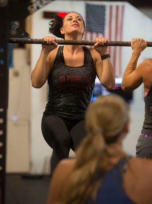 Emily Bailly works out at CrossFit Pace Patriot Pride on Saturday, Sept. 2, 2017. Bailly is training so she can attempt to summit to the Mount Everest base camp.
