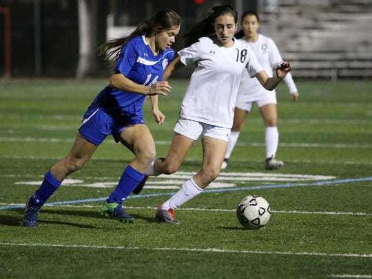 Cougars midfielder Caroline Peterson (16) dribbles up the field during a rivalry match between Barron Collier and Gulf Coast earlier this season.