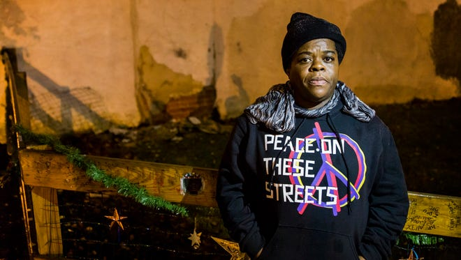 Margie Cropper-Frazier stands near a makeshift memorial for her son Antonio Cropper at the corner of Jefferson and Seventh Streets in Wilmington on Dec. 2. Cropper was shot and killed near the corner on June 15.