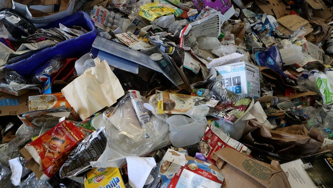 Paper, boxes and plastic that the city of Redding pulls from curbside recycling bins waits to be sorted at the city's recycling facility. About 35 percent of the items Redding residents put in their containers ends up in the landfill because it can't be recycled.