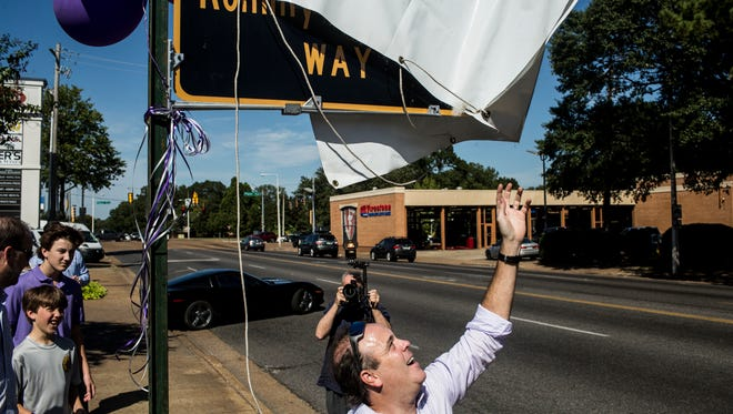 October 03, 2017 - Josh Hammond unveils the sign marking a stretch of Highland between Poplar and Central named after his father and late owner of Buster's, Rommy Hammond Way.