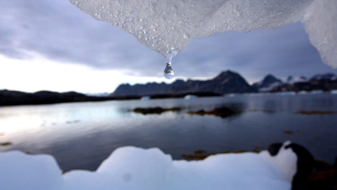 An iceberg melts in Kulusuk, Greenland, near the Arctic Circle in this Aug, 16, 2005, file photo.